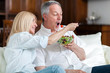Healthy senior couple eating salad