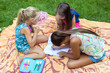 Young girls drawing at the park