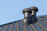 Ventilation chimneys on roof of a house - 188268042
