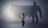 Cute kid with hero shadow behind - 188270637