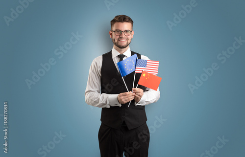 Foto Murales Handsome student standing with national flag