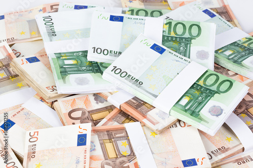 Pile of fifty and one hundred euro banknotes