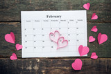 Pink hearts with february calendar on wooden table - 188292851