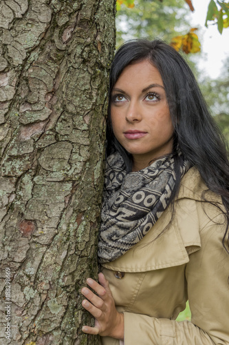 young woman with tree