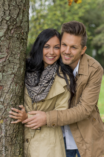 couple in love behind a tree - 188298841