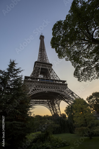 Sticker Eiffel Tower at sunset in Paris, France. Romantic travel background.