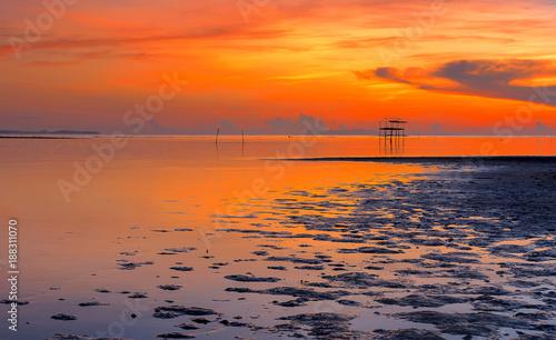 Poster Oranje eclat Lonely hut in sea at sunrise