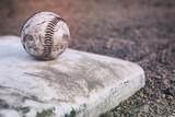 Baseball sitting on a base - 188314884