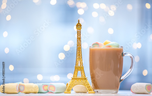 Eiffel tower souvenir statue and marshmallows with cup of coffee
