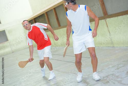 Fototapeta Men playing racket sport
