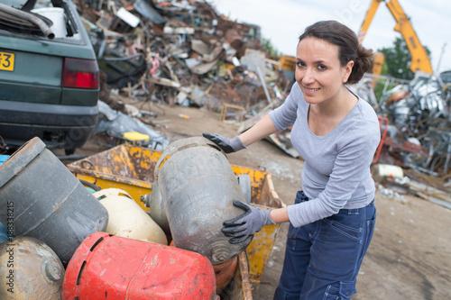 female worker at a scrap yard