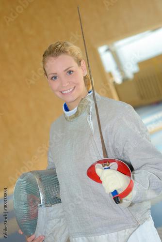 Foto Murales Portrait of woman wearing fencing gear