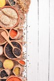 Set of Groats and Grains. Buckwheat, lentils, rice, millet, barley, corn, black rice. On a white wooden background. Top view. Copy space. - 188343658