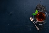 A cup of black tea on a wooden background. Top view. Copy space. - 188343686