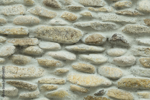 Staande foto Stenen stone wall texture or background.