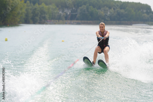 young woman water skiing on a lake