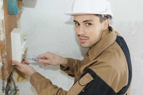 Portrait of electrician using screwdriver
