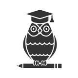 Owl in graduation cap on pencil glyph icon