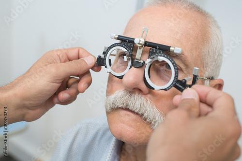 Foto Murales eye examination at the slit lamp