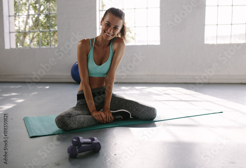 Fridge magnet Woman taking break after workout at health club