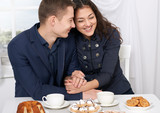 happy couple drinking coffee and having fun, window with a sky view on background - travel and love concept