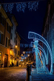 Night street decorated with Christmas angels in Parma, Emilia-Romagna, Italy