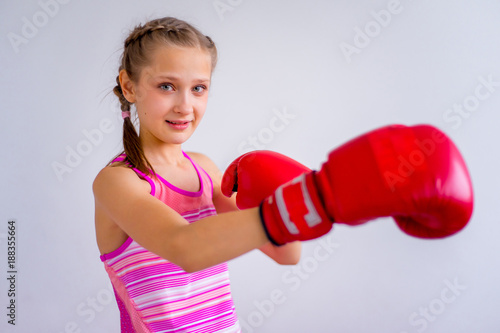 Teen girl boxing
