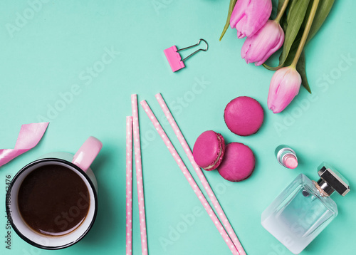Womans accessories, coffee and pink tulips.