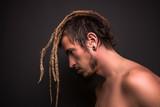 Portrait of a blonde boy with dreadlocks