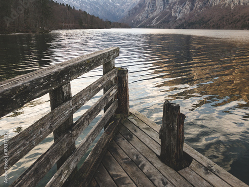 Fotobehang Pier Mountain lake with wooden pier. Amazing view. Natural beauty.