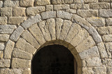 semicircular arch at the entrance of a small chapel Romanesque architecture style. half-point arch - 188372496