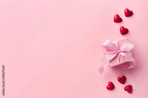 Pink gift box and red hearts