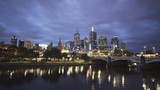 night time wide angle view of a boat on the yarra river with the australian city of melbourne in the background - 188376220
