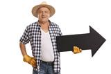Elderly farmer holding an arrow - 188376875