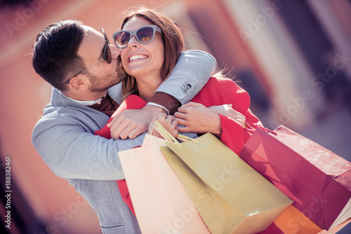 Young smiling couple shopping in the city