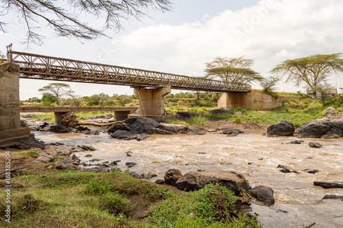 Iron Bridge on the Mara River between Maasai Mara Park in North West Kenya and Serenghetti Park in Tanzania - 188385204