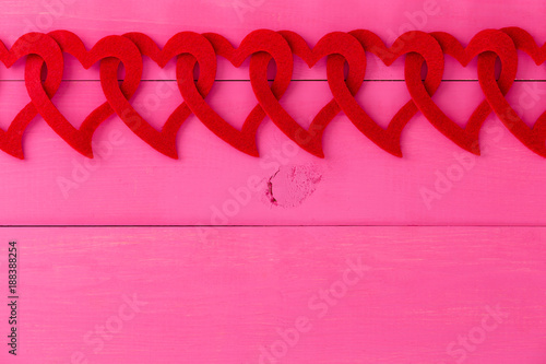 Romantic border of red hearts linked in a chain - 188388254