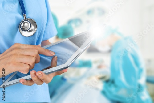 Doctor with digital laptop. - 188390289