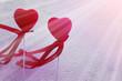 heart symbols through the texture of frozen glass