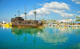 Pirate ship and fishing boats in harbor of Ayia Napa, Cyprus.