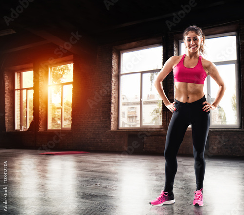 Poster Determinated girl at the gym ready to start fitness lesson