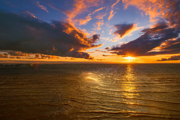 Sunset in the wild. Orange clouds. Sunset at the sea.