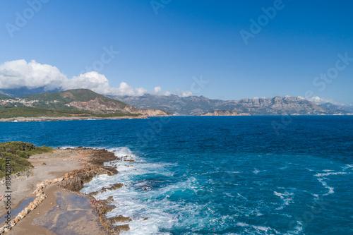Foto Murales Aerial view of the coast of Montenegro. Storm waves on the Ploče beach.