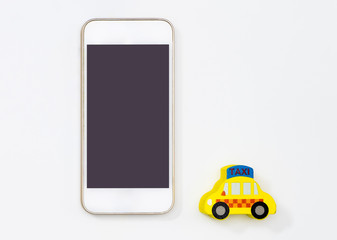 Empty mobile screen with taxi toy for taxi calling application mock up