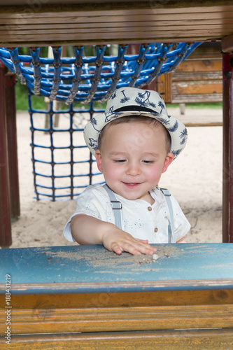 Adorable boys having fun on the playground