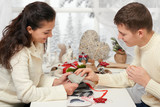 young couple making decorations for Valentine's day, happy people - romantic and love concept
