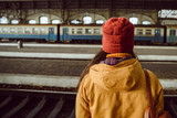 woman wiating for train on railway station