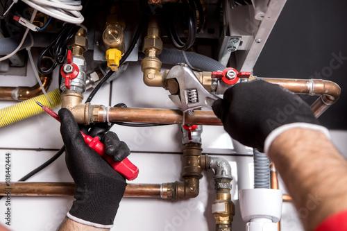 Leinwandbild Motiv plumber fixing central heating system