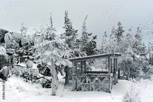 Foto Murales a frosty winter gazebo in a winter natural mountain landscape reminiscent of a garden of stones and bonsai