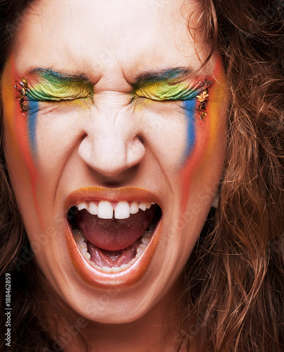 Foto Murales  Screaming woman with creative professional make-up